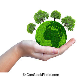 Hand holding green planet with trees