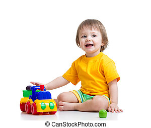 kid boy toddler playing with toy