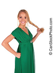 Girl in green holding her plait