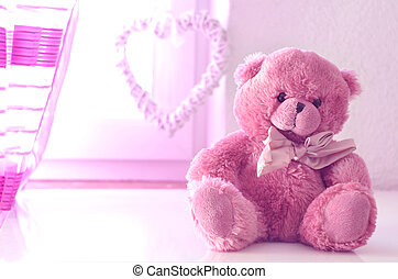 Romantic still life with pink plushy teddy bear in the...