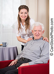 Social care worker and senior - Portrait of social care...