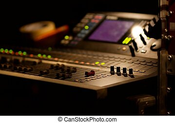 Mixer - Soundboard mixer at a concert, shallow focus