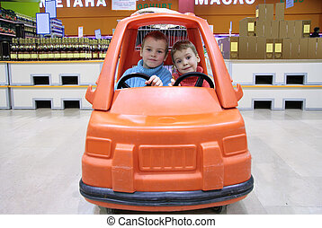 children in toy automobile in supermarket 2