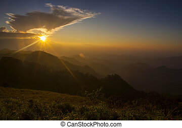 Majestic sunset in the mountains landscape. Dramatic sky