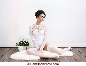 Sensual and beautiful young girl in a bridal lingerie over...