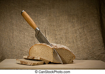 A slice of bread with butter on a chopping board