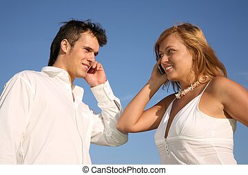 couple talk on cell phones