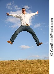 man jumps on meadow