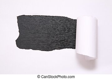 the sheet of torn paper against the black background
