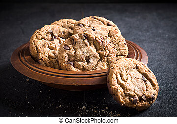 Chip cookies - Homemade chocolate chip cookies in the wooden...