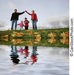 children in family house autumn river
