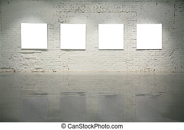 frames on white brick wall