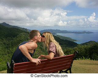 kissing couple on bench