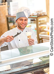 Ice cream seller - Confectioner selling ice cream in the...