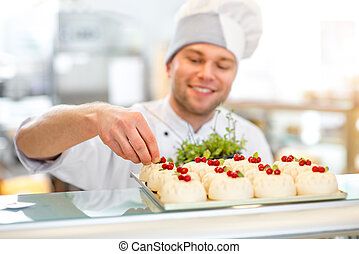 Confectioner with cakes - Handsome confectioner in uniform...