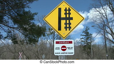 Danger sign close to railway tracks in Guelph, Ontario,...
