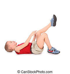 boy lie isolated on white pain leg