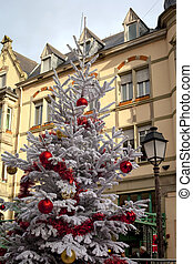 White Christmas tree in town - White Christmas tree with red...
