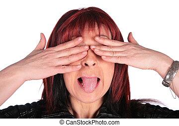 Woman close eyes and showing tongue