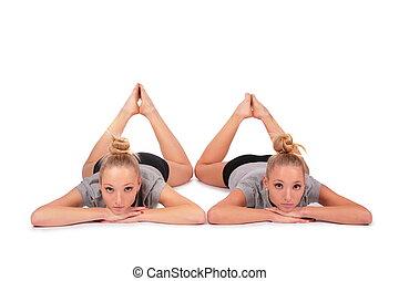 Twin sport girls lying on floor