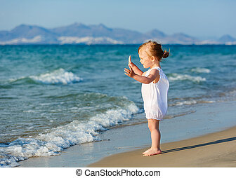 Little girl on the beach - Little girl enjoying the beach