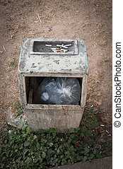 Garbage bin with ashtray in the park