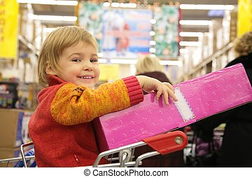 girl with box in store