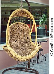 Hanging rattan chair for seating