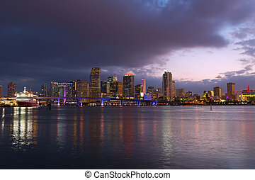 Miami city skyline at dusk. Urban landscape of Miami downtown with reflections.
