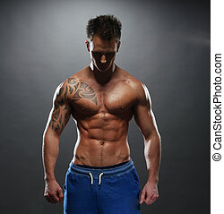 portrait of the athlete - Topless Athletic Man with Tattoo...