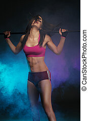 Athletic Woman with Fitness Bar on her Shoulders