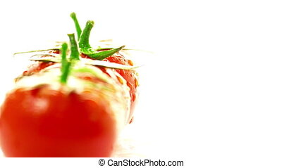 Tomato red on a white background - Red tomatoes spinning on...