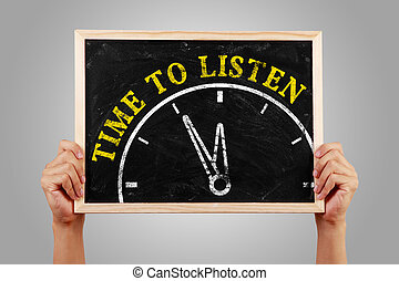 Time to listen - Hands are holding the blackboard of time to...