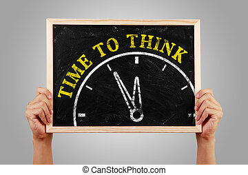 Time to think - Hands are holding the blackboard of time to...