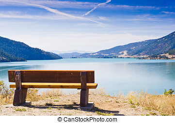Park bench overlooking lake - A park bench overlooks...