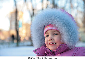 little girl onstreet in winter