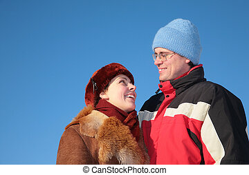 couple against blue sky background in winter 3