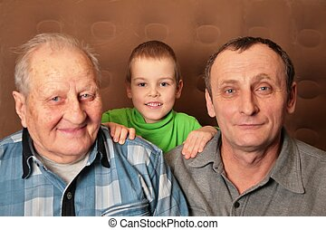 two elderly men with boy