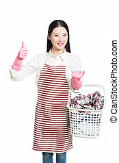 woman doing a housework holding basket of laundry