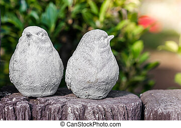 Statues two birds in garden