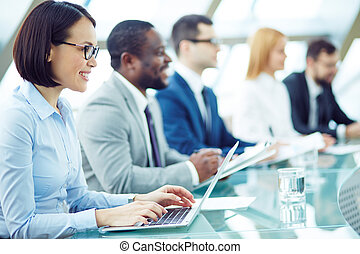 Attentive people - Business people sitting attentively at...