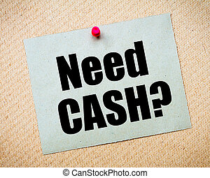Need Cash Message - Recycled paper note pinned on cork...