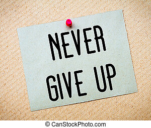 Never Give Up Message - Recycled paper note pinned on cork...