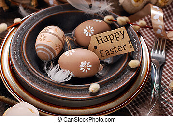 easter eggs and paper tag with greetings in plate on rustic...