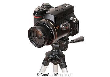 Modern photo camera on tripod