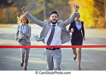 Winner - Businessman reaching finish line