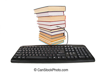 Stack of books with a connected black keyboard