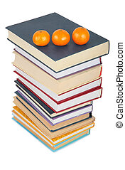 Stack of books with three mandarins