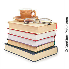 coffee cup and glasses on pile of book