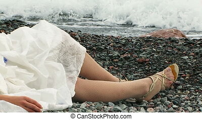 Beautiful Woman Relaxing on Beach At Dull Day - Beautiful...